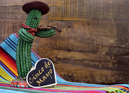 mayo: fun Mexican cactus and blackboard sign with text against a dark retro wood background  Stock Photo