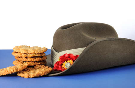 armistice: Australian army slouch hat and traditional Anzac biscuits on white Stock Photo