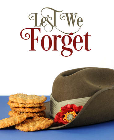 Australian army slouch hat and traditional Anzac biscuits with lest we forget text on white background photo