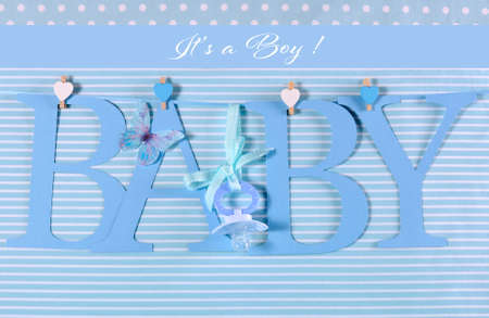 its a boy: Its a boy, blue theme Baby bunting letters under from pegs on a line for nursery, greeting card or baby shower. Stock Photo