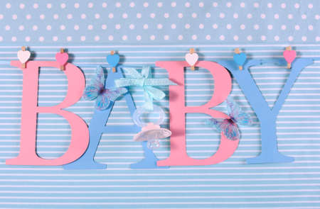 Pink and blue theme Baby bunting letters under from pegs on a line for nursery, greeting card or baby shower. photo