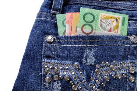 Australian money in back pocket of feminine ladies rhinestone decorated jeans photo