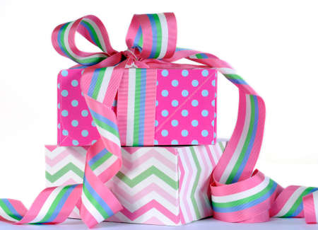Beautiful candy color gifts with bright pink and blue polka dots with pink, blue, green and white stripe ribbon for birthday, baby, bridal shower, wedding, Easter, Christmas, Fathers Day or Mothers Day  photo