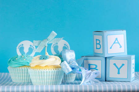 its a boy: Blue theme baby boy three cupcakes and baby favour gift boxes  Stock Photo