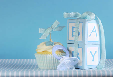 Blue theme baby boy cupcake with dummy pacifier and gift boxes  photo