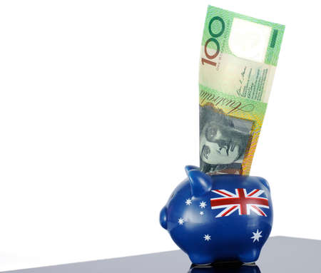 Australian money, one hundred dollar note, in red white and blue piggy bank  photo