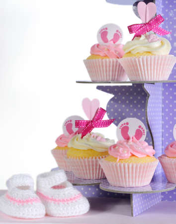 its a girl: Pink theme baby girl cupcakes and booties on purple polka dot cupcake stand