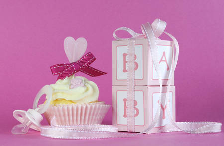 its a girl: Pink theme baby girl cupcake with dummy pacifier and favor gift boxes