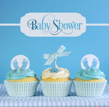 Blue theme baby boy cupcakes with greeting sample text in vintage style  photo