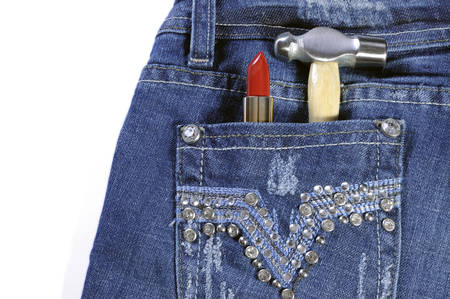 Female worker blue jeans with rhinestone decoration and red lipstick and hammer in back pocket for crafting or construction, isolated on white background. photo
