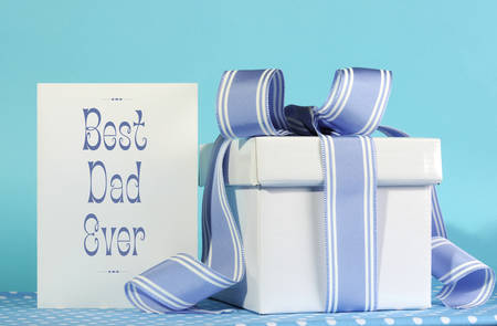 Happy Fathers Day, Best Dad Ever, greeting card with blue and white gift box on blue background.