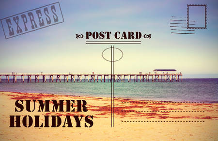Retro vintage filter style old faded Summer Holidays Vacation postcard with jetty pier boardwalk on calm ocean beach. photo