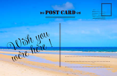 Wish You Were Here summer vacation postcard with scenic ocean beach view Stockfoto