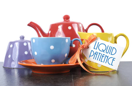 creamer: Red, blue, yellow, orange and purple polka dot tea set with teapot, milk jug creamer, sugar bowl and tea cup with sample text Liquid Patience for morning or afternoon coffee break.