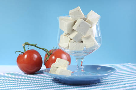 Health food healthy diet food group, dairy free products, with soy tofu in elegant glass bowl on blue background. photo