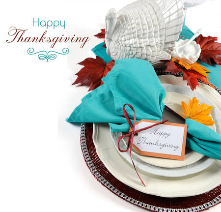 Happy Thanksgiving dining table place setting with vintage turkey tureen in Autumn brown and aqua color theme with copy space and sample text. Stock Photo