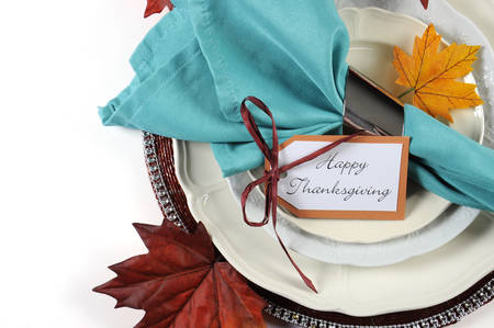 holiday meal: Happy Thanksgiving dining table place setting in Autumn brown and aqua color theme with copy space. Stock Photo