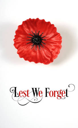 anzac: Lest We Forget, Red Flanders Poppy Lapel Pin Badge for November 11, Remembrance Day appeal. on white background with Lest We Forget sample text. Vertical.