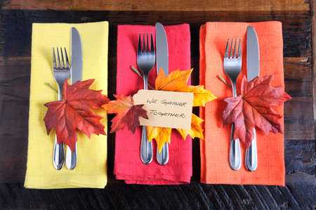 to place: Happy Thanksgiving table place setting with We Gather Together place card and autumn fall leaf decorations