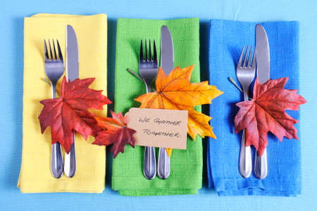 celebration party: Happy Thanksgiving table place setting with We Gather Together place card and autumn fall leaf decorations