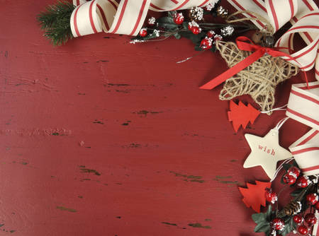 Festive Christmas and Happy Holiday background on dark red vintage recycled wood background with copy space for your text here. photo