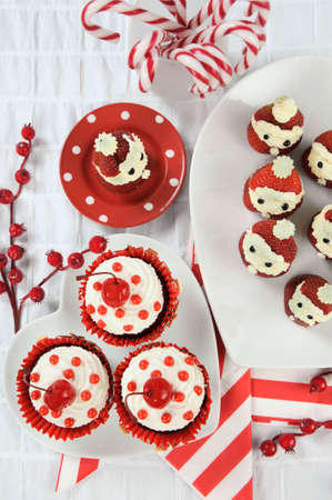 holiday food: Christmas holiday dessert party food in modern red and white trend - vertical. Stock Photo