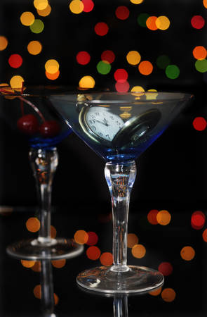 happy new year eve party with pocket watch with five to midnight time and martini cocktail