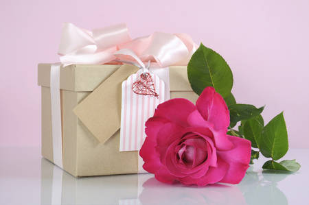 sincerity: Beautiful classic kraft paper cardboard gift box with pale pink ribbon and rose Stock Photo