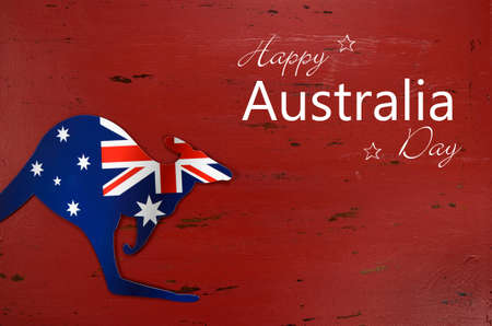 australia day: Australia Day background with kangaroo shape Australian flag on red rustic recycled wood background with sample text.
