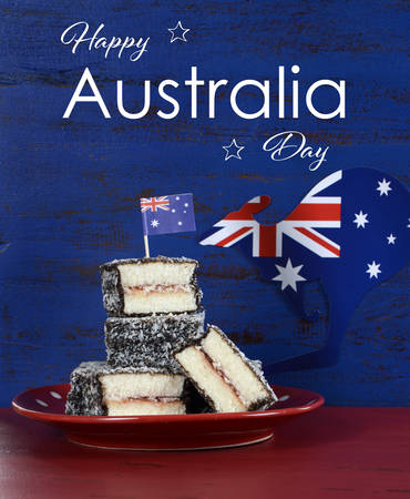 downunder: Happy Australia Day January 26 party food with iconic Australian lamington cakes on dark red and blue vintage rustic recycled wood background, with sample text.