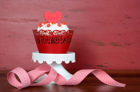red velvet: Happy Valentine red velvet cupcake with love messages on red vintage wood background with copy space.