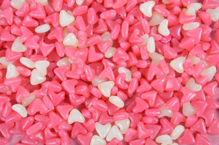 confectionary: Pink and white heart shape jelly candy confectionary background. Stock Photo