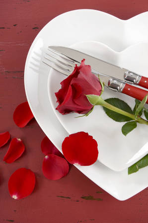 china rose: Happy Valentines Day table place setting on red vintage wood background with red rose, vertical.