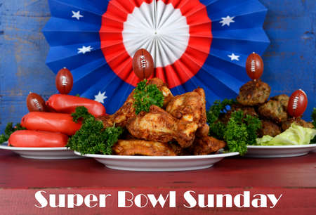 super bowl: Super Bowl Sunday football party celebration food plates with chicken buffalo wings, meat balls, hot dogs and USA party decorations, with text. Stock Photo