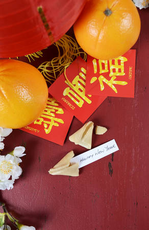 old new: Happy Chinese New Year celebration party table on red wood background.