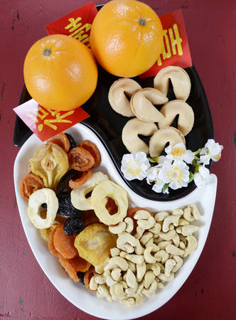 party tray: Happy Chinese New Year celebration party tray of togetherness on red wood background. Stock Photo