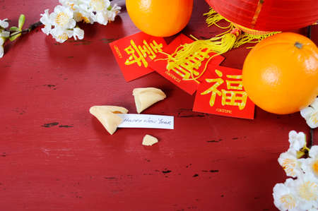 Happy Chinese New Year celebration party table on red wood background.