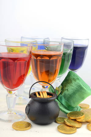 Happy St Patricks Day party rainbow color drinks with decorations on vintage wood table. photo