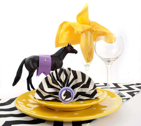 horse racing: Horse racing carnival event luncheon table place setting in purple, yellow theme, and black and white chevron strip table runner.