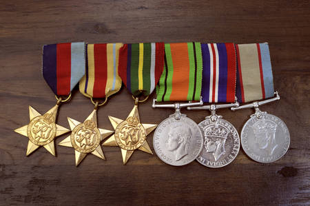 anzac: ADELAIDE, AUSTRALIA - APRIL 2, 2014: Original Australian Army World War II campaign medals including the 1939 – 1945 Star, The Africa Star, The Pacific Star, The Defence Medal, The 1939 – 1945 Medal and The Australian Service Medal.