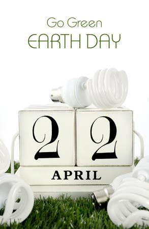 Earth Day, April 22, concept with energy saving light bulbs surrounding white wood block calendar. photo