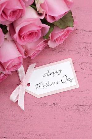 mothering: Happy Mothers Day Pink Roses on Vintage style distressed pink wood table.
