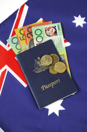 affluence: Australian Money with passport for travel concept.