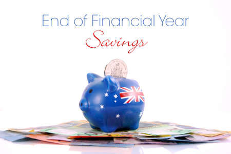 the end of the year: Australian Money with Piggy Bank for saving, spending or end of financial year sale.