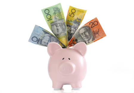 white piggy bank: Australian Money with Piggy Bank for saving, spending or end of financial year sale.