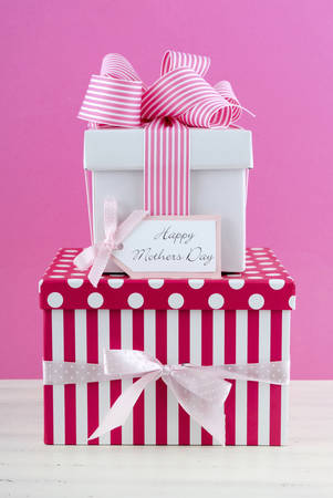 nurture: Happy Mothers Day pink and white gift with greeting card, on white shabby chic distressed wood table.