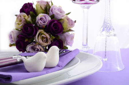 place setting: Purple theme wedding table place setting with heart shape plates and vintage silverware.
