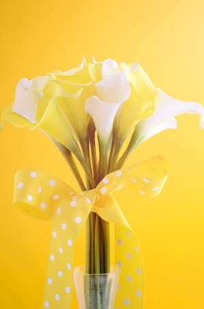 nosegay: Yellow and white theme calla lilly wedding bouquet, with applied retro style filters and added lens flare.