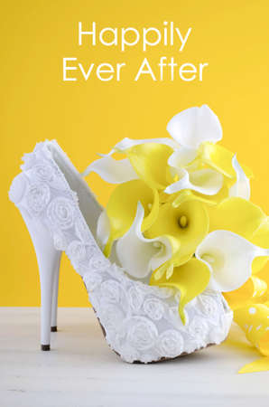 happily: Beautiful white high heel shoe on white shabby chic table with Happily Ever After text,