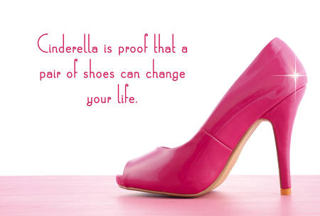 beautiful cinderella: Pink high heel shoe on pink wood shabby chic table with Cinderella Is Proof quote. Stock Photo